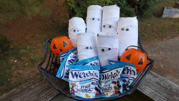 This Halloween Craft will show you how to make a Paper Roll Mummy. The best part, they hide a surprise inside!  #halloweencraftsforkids #halloweendecorations #halloweencrafts #paperrollmummy
