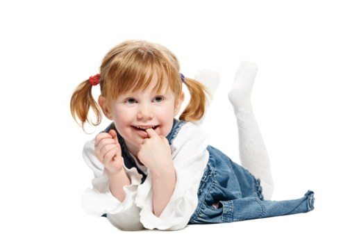 Little lying joyful girl with ponytails and risen foots on white background