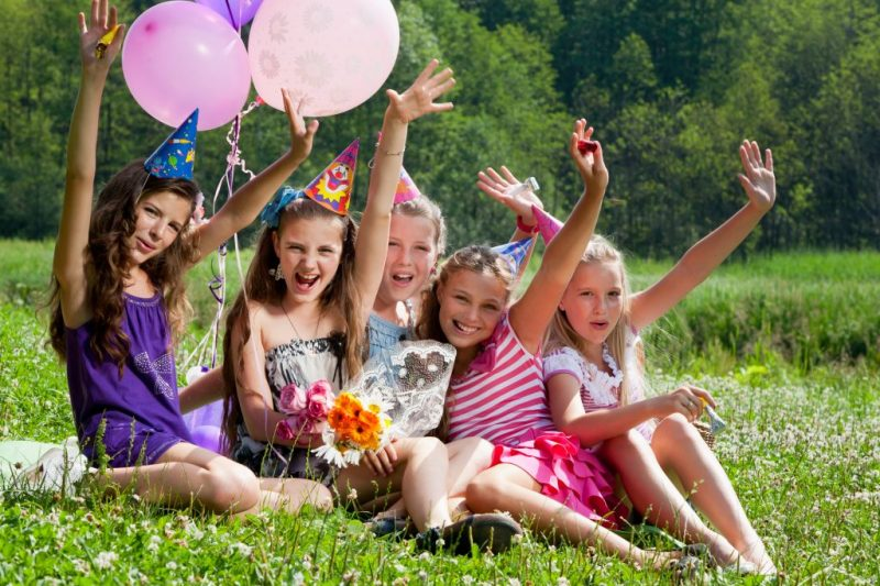 beautiful girls celebrate birthday in summer park outdoors