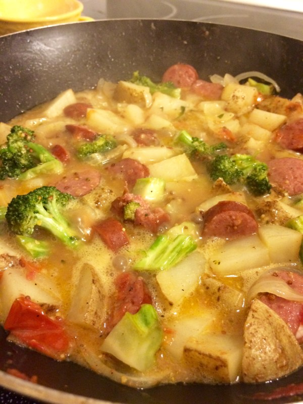 The broccoli and potatoes to perfection will cook in the broth you created with that yummy smoked sausage and onions!