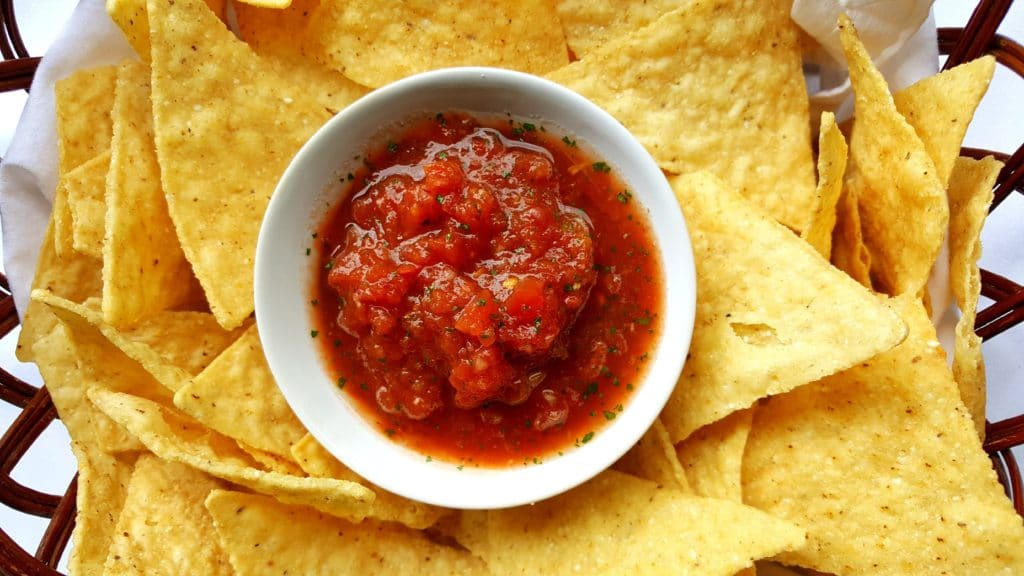 restaurant style salsa and tortilla chips in a basket