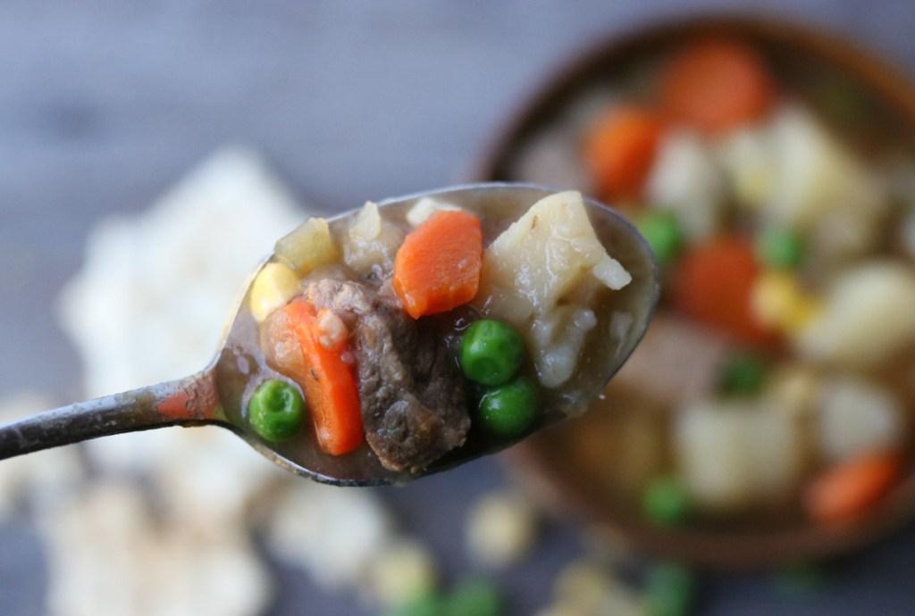 A bite of INSTANT POT Steak Soup momsdinner.net
