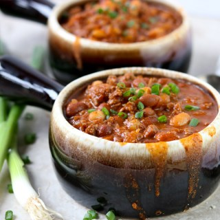 Two bowls of Classic Chili with green onions