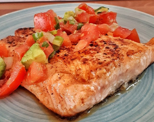Place salmon filets on plate and generously cover with each filet with toamato and avocado salsa sauce.