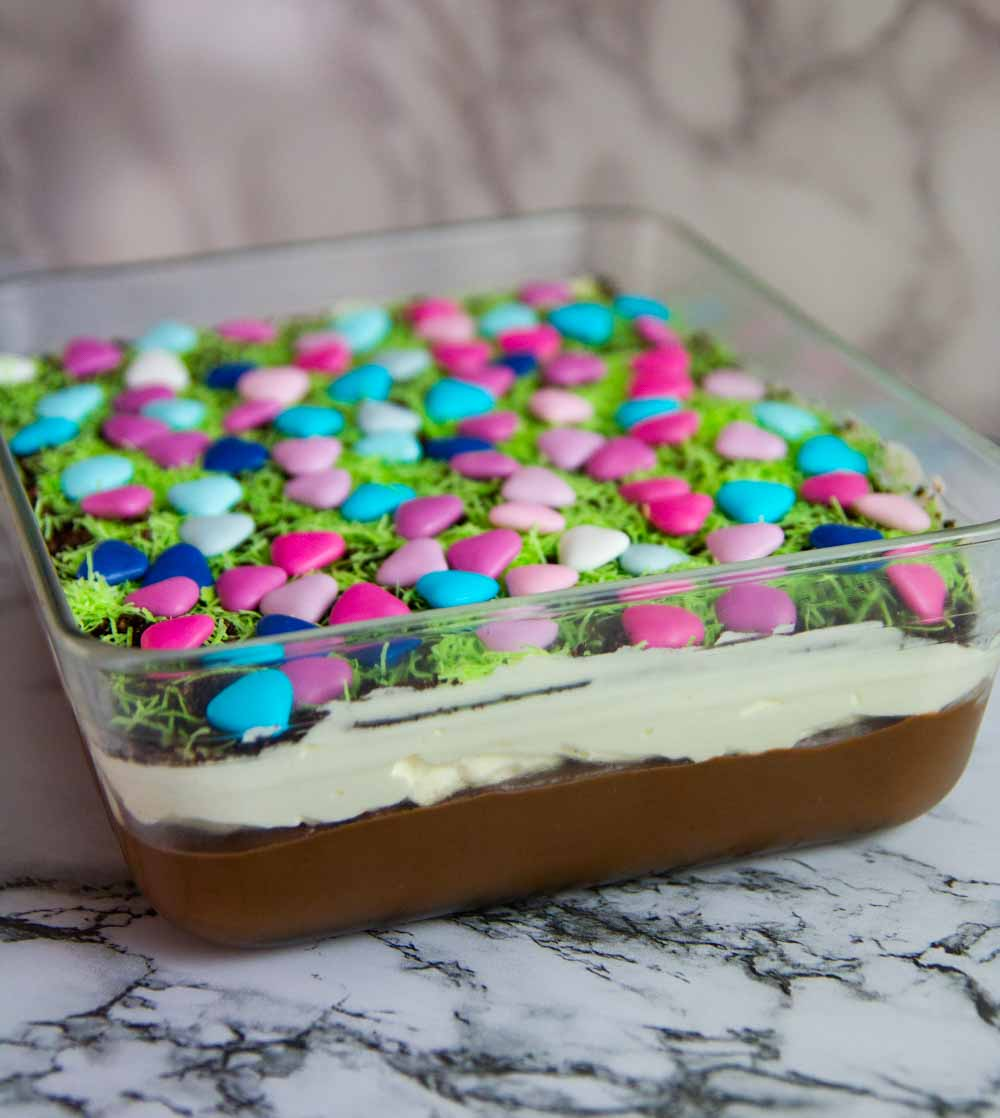 Easter Dirt Cake is a creamy and delicious dessert filled with Oreos, chocolate pudding, cheesecake that everyone will love to decorate and eat! #easterdessert