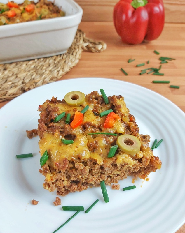 This Keto Taco Casserole is a delicious low-carb ground beef and cheese recipe that is very easy to make. Perfect for a family weeknight dinner!#ketotaco #ketocasserole