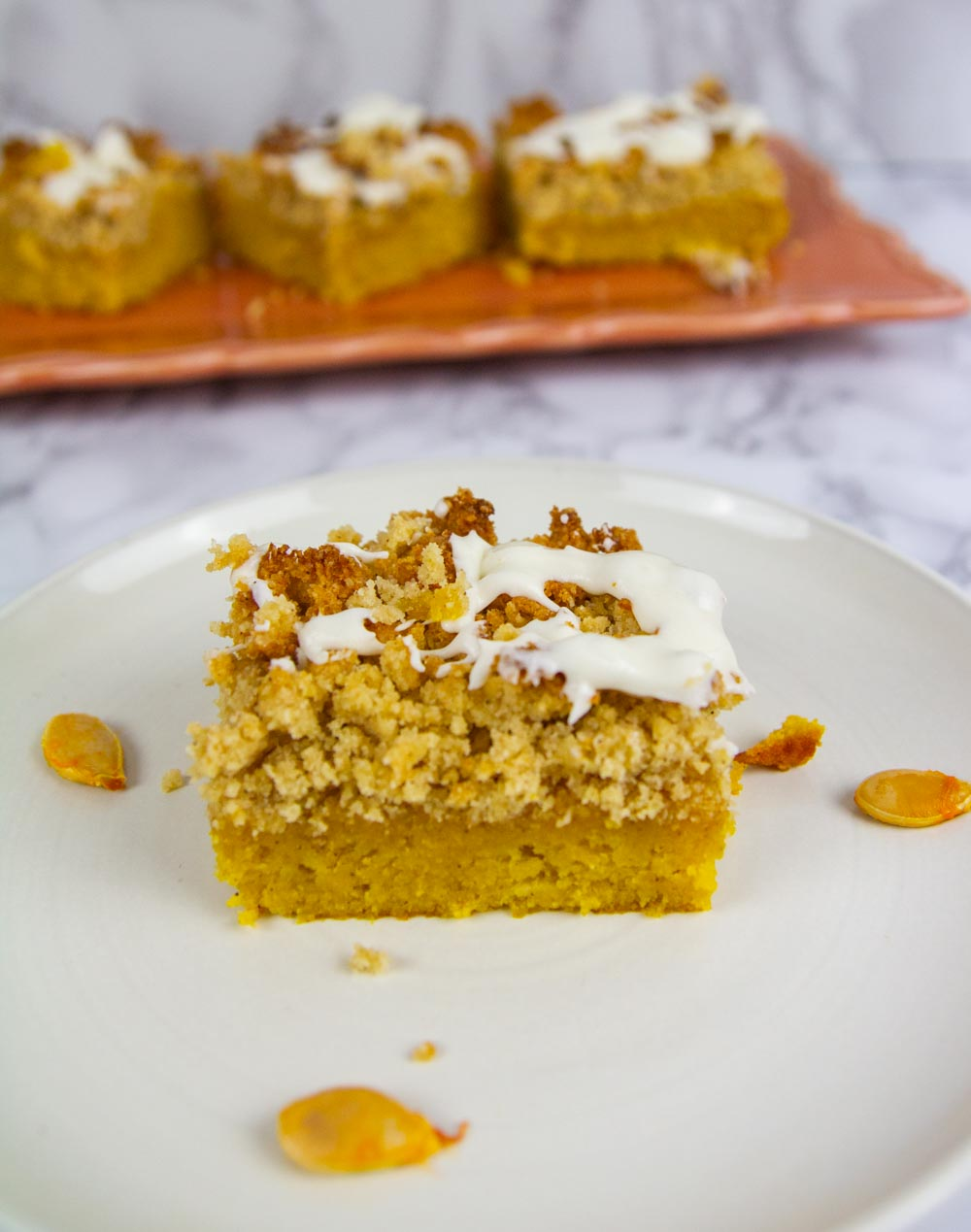 "Pumpkin Spice Coffee Cake features a moist pumpkin cake loaded with brown ""sugar"" cinnamon streusel and topped with a vanilla glaze. Such a family favorite! #ketocake #coffeecake"