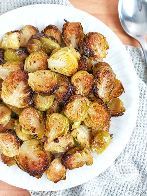 Crispy Roasted Brussels sprouts are not just incredibly easy to prepare, but also, one of the most popular holiday side dishes! Keto and low-carb friendly as well! #brusselssprouts #sidedish #keto #ketosidedish #holidaysrecipes #christmasrecipes #christmassidedish