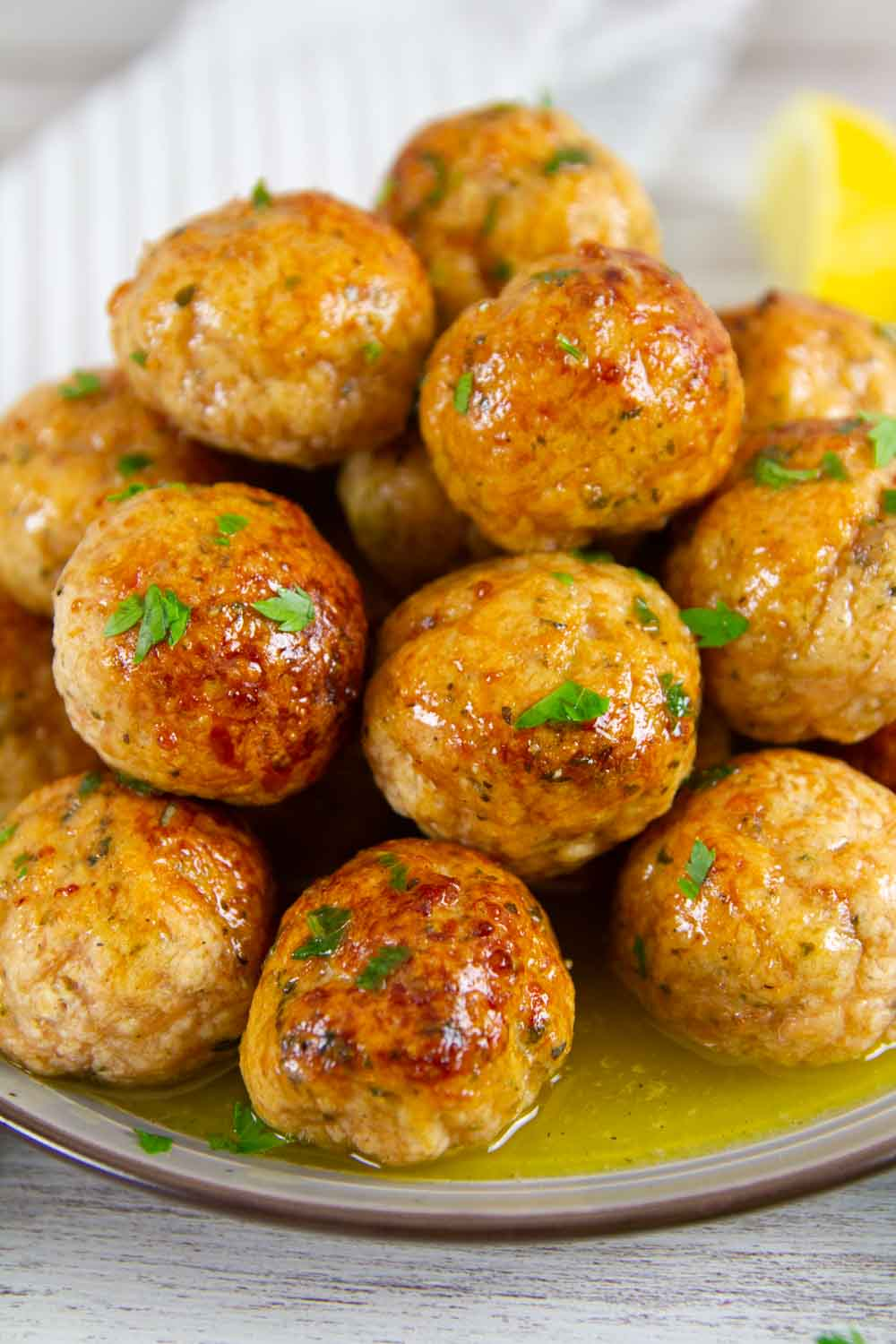 These Healthy Baked Chicken Meatballs are made with ground chicken and simple pantry ingredients and baked to crispy perfection in the oven. They're a perfect low carb dinner!