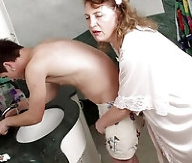 Busty Mature Blows And Fucks A Young Dude In Bathroom