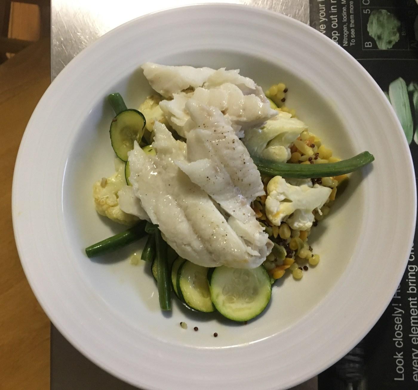 Braised fish over cous cos, beans, cauliflower & zucchini