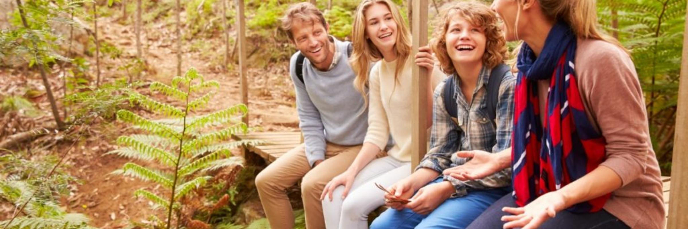 motts_sliderFamily sitting in woods during fall