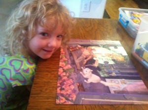 "She is getting the hang of how to put together a puzzle.  She probably did about a third of this one on her own. I ""suggested"" the placement of the rest."