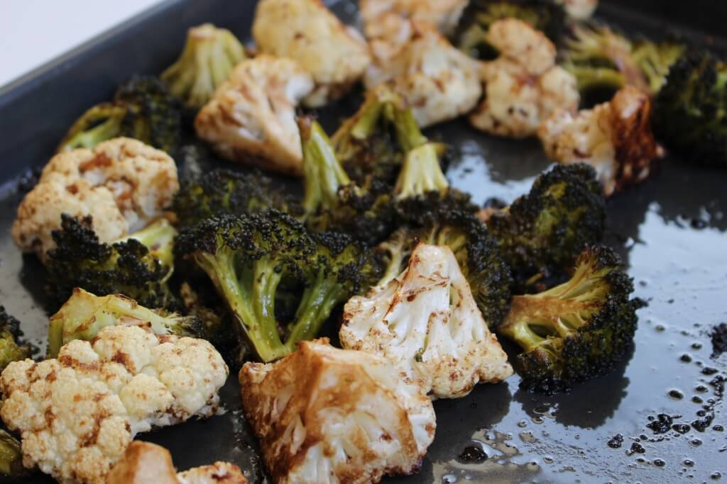 Balsamic and Honey Roasted Broccoli and Cauliflower makes vegetables delectable for all ages with a simple, sweet dressing!