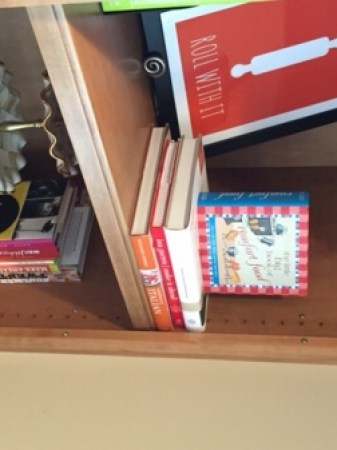 kitchen shelves with cookbooks