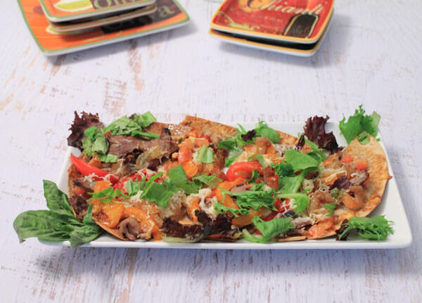 Philly Cheesesteak Flatbread is a healthier spin on the traditional Philly Cheesesteak Sandwich. Loaded with veggies and plated on a flatbread, you're family will come back for seconds!