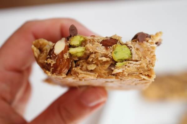 No Bake Nut Lover's Bars are a combination of smooth peanut butter and chopped nuts, packed with healthy fats and protein, and topped with a drizzle of hazelnut spread.