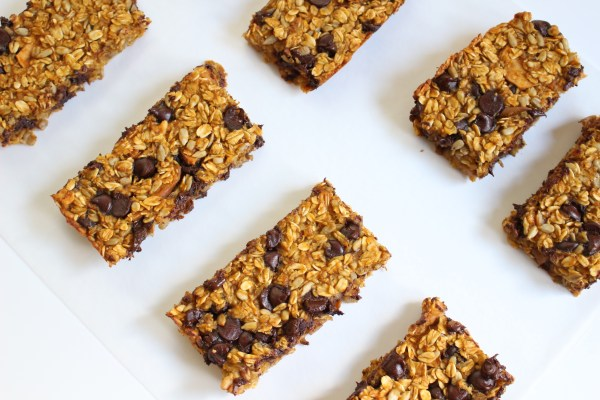 Chewy pumpkin chocolate chip bars taste just like the holidays--- made with pumpkin, chocolate chips, and the crunch of whole grains.
