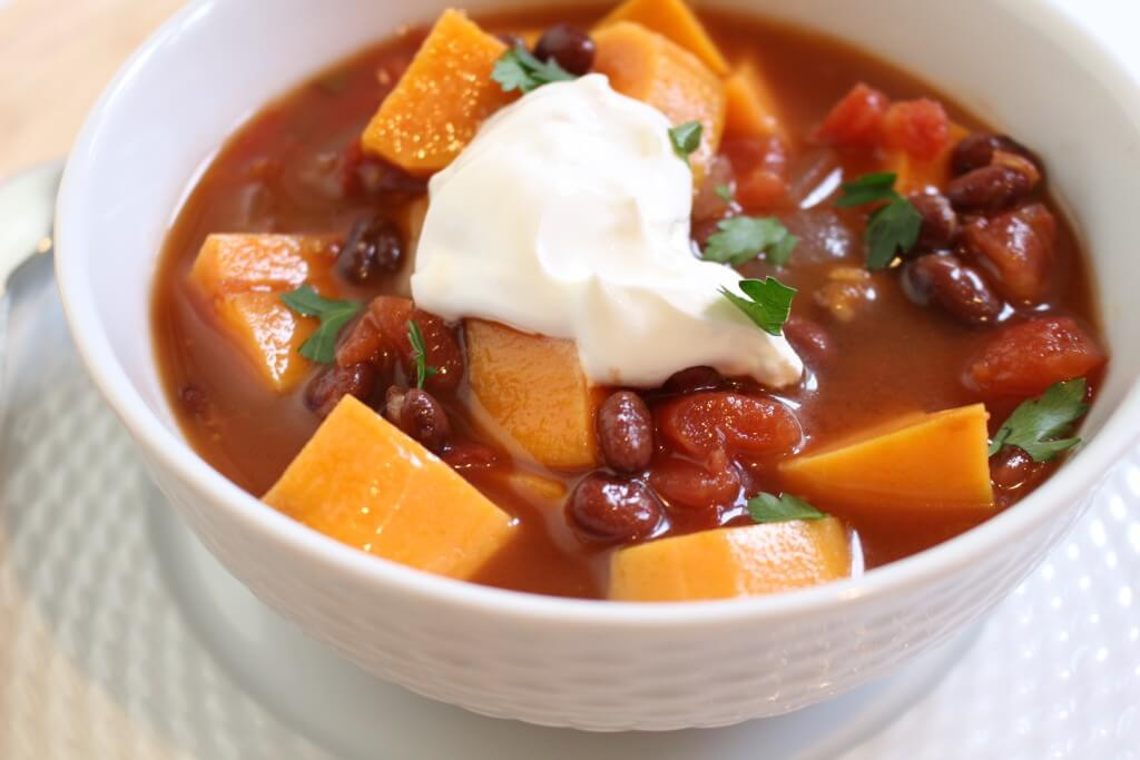 This sweet potato and black bean chili is a hearty vegetarian option perfect for a simple slow cooker dinner and easily frozen another busy weeknight meal.