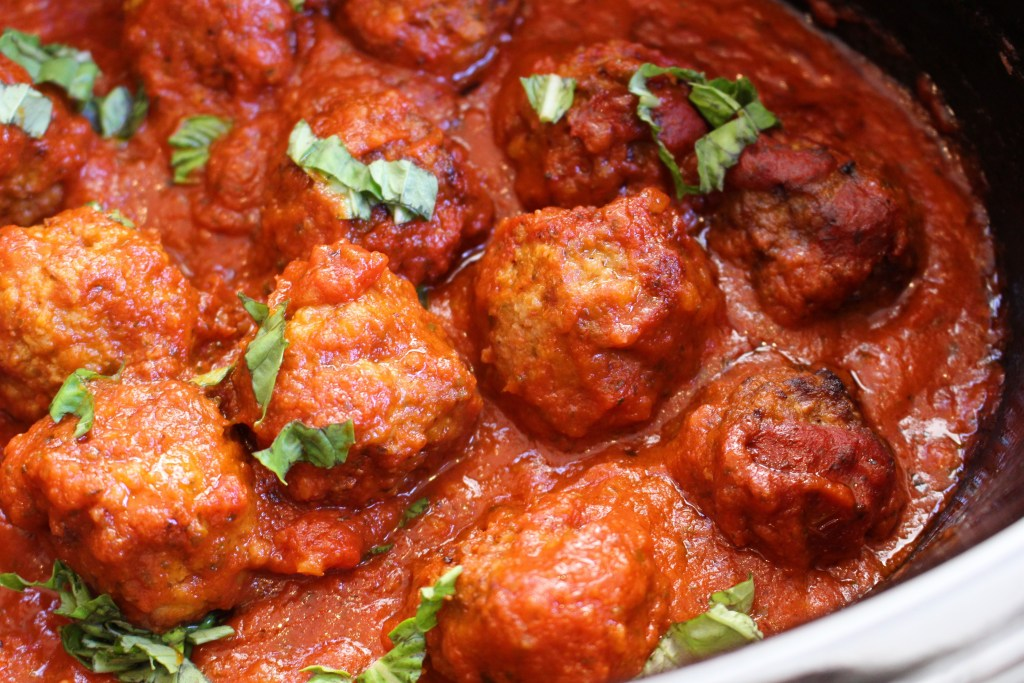 Meatballs made with lean ground beef and cooked with a simple tomato sauce in a slow cooker are the perfect cook once dine twice meal!