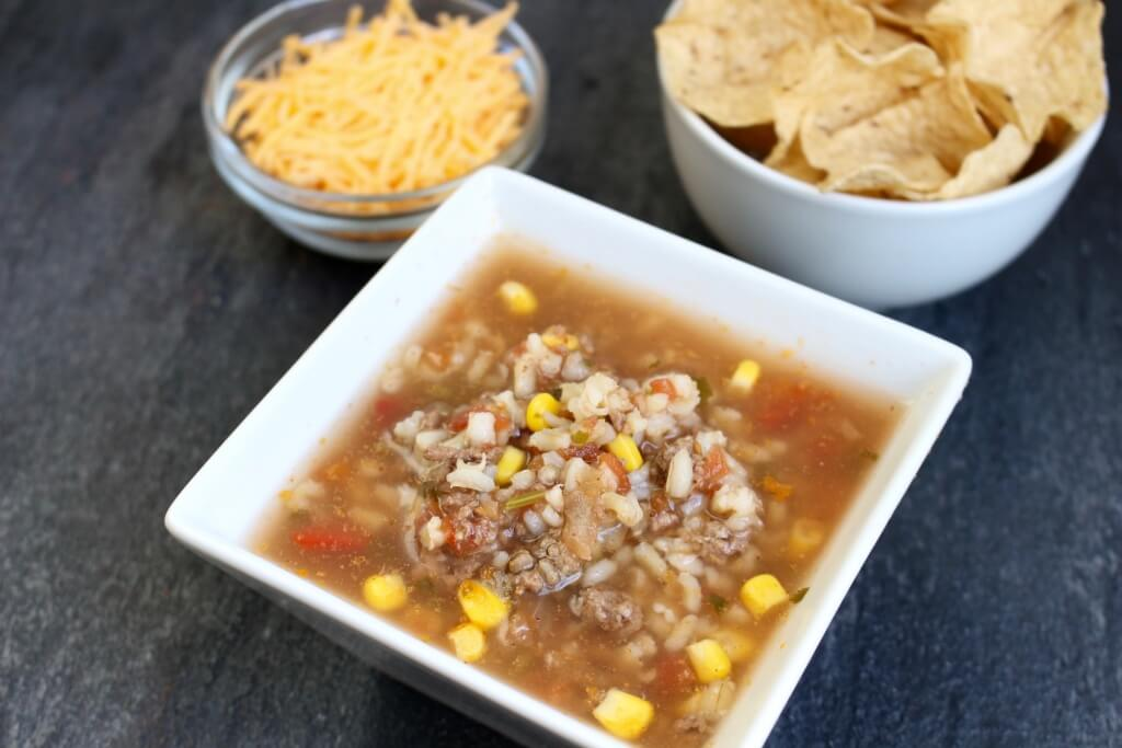 Slow Cooker Taco Soup made with veggies, salsa, and lean Ground Beef is full of traditional taco flavor but served as a soup!