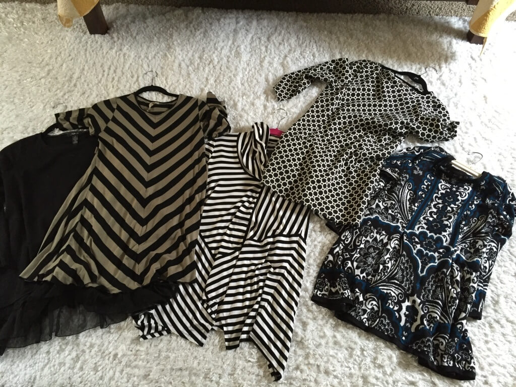 Note: I took a picture of these clothes for a friend who needed to borrow a few maternity tops. Black is slimming on pregnant women and clearly I'm going for that this time around...