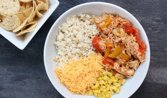 Slow cooker chicken enchilada bowls are the easy AND healthy way to make enchiladas. Without all the rolling that comes with traditional Mexican-inspired dish!