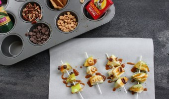 Caramel apple pops are an easy and delicious way to eat a traditional caramel apple. Get the kids involved in topping their own with dried cereal, chocolate chips, or extra caramel sauce!