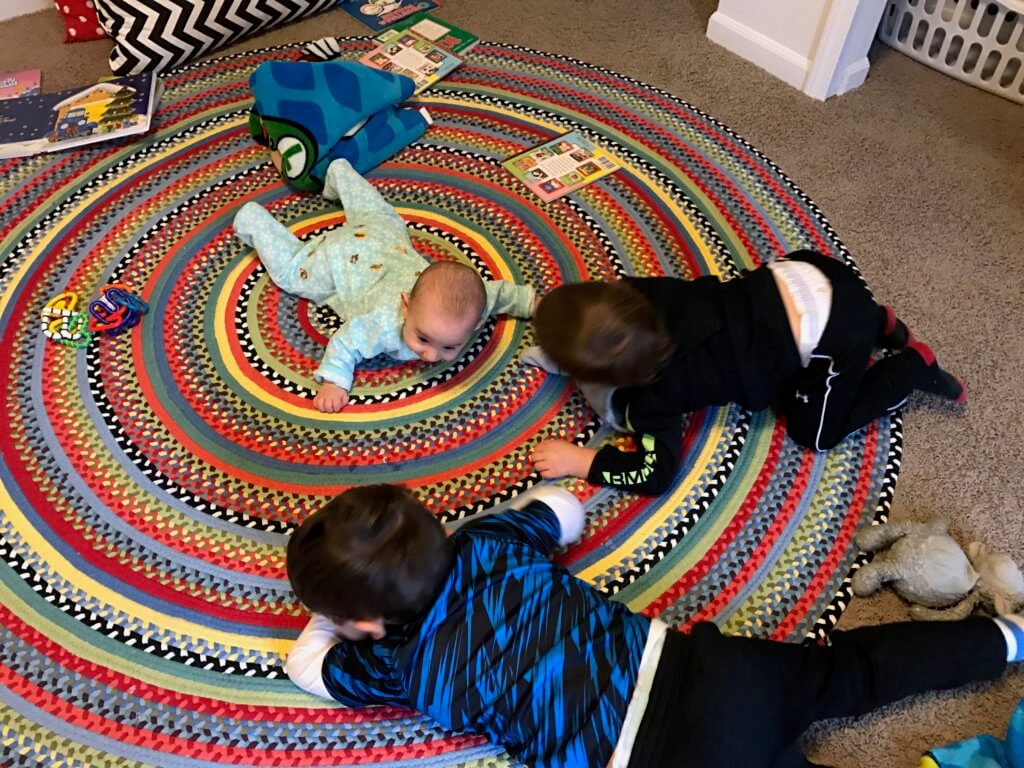 The whole crew doing tummy time! Notice the extra dinosaur sticker decor on Lily's back side... what are brother's for?!