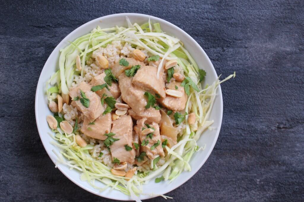 Slow cooker peanut chicken is a creamy chicken dish in a simple peanut sauce finished off with fresh lime juice, making mealtime SO easy and delicious!