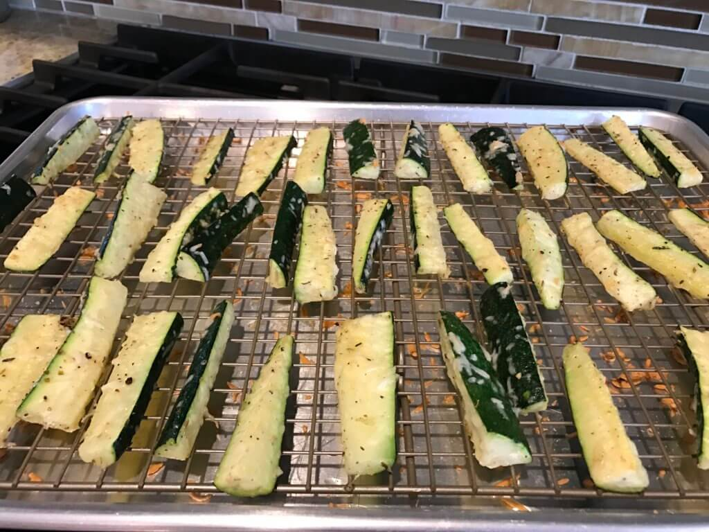 Parmesan zucchini sticks are baked to perfection and full of cheesy parmesan flavor! A simple side dish or appetizer, served best with marinara sauce for dipping!