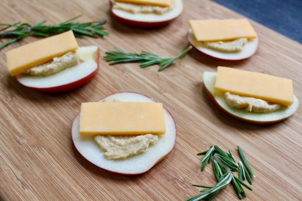Apple hummus stackers make one protein-packed snack, appetizer, or post-workout treat that's ready in one simple step, with just 3-ingredients: apples, hummus, and cheddar cheese!
