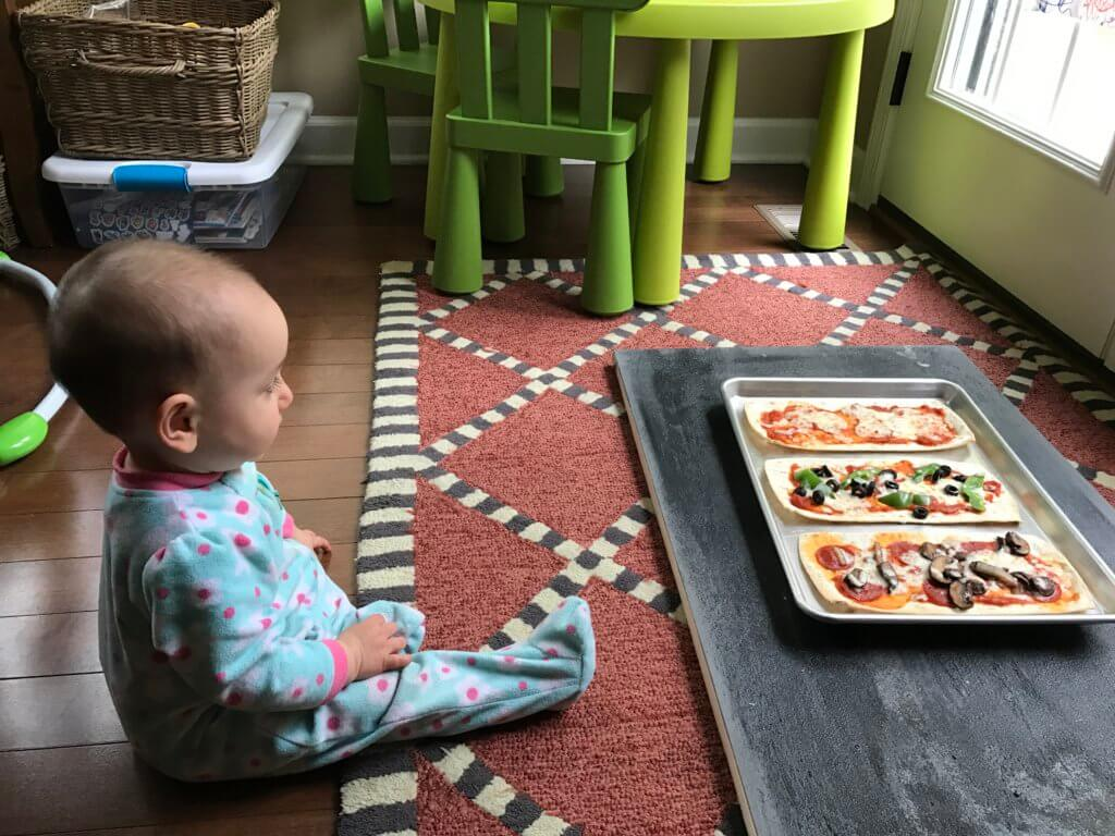 Pizza for dinner, again? Yes! Change-up your weekly pizza routine with a build your own pizza bar for dinner! The best part? The kids can make their own.