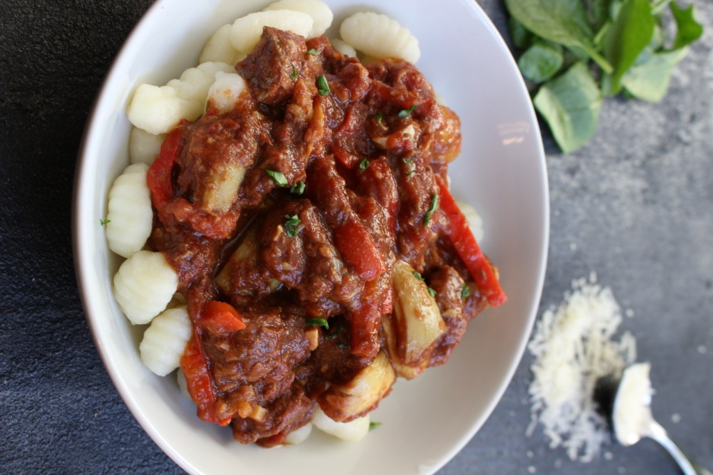 A simple rustic slow cooker Mediterranean beef recipe which includes Mediterranean flavors like basil and oregano, and tender beef that will fall apart in your mouth!