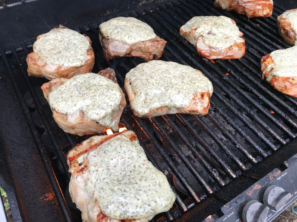 Grilled pork chops with lemony dill sauce make a delicious main for any BBQ or outdoor gathering. Fresh, fast, and simple, the sauce is what makes the pork extra moist!