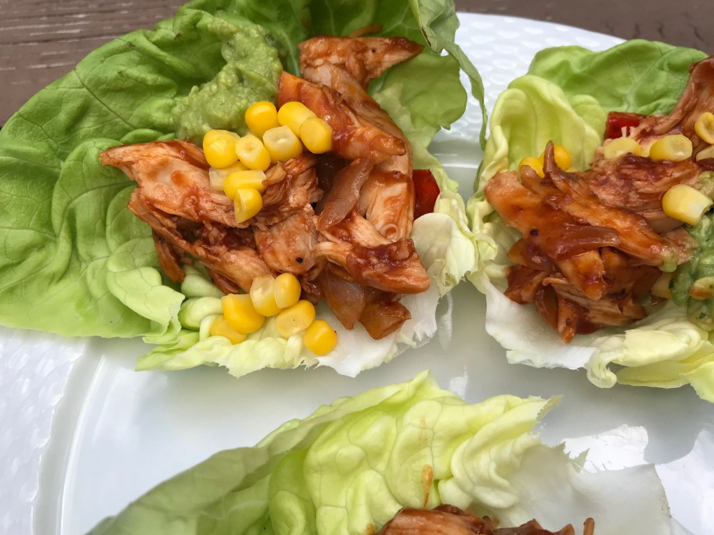A rotisserie chicken, BBQ sauce, and a few vegetable staples make these Tex-Mex Chicken Lettuce Wraps one simple and fast low-carb meal.