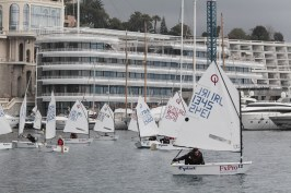 Monaco Optimist Team Race boats in the Bay with the YCM in the background @ Franck Terlin
