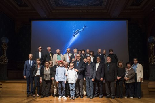 Prince Albert surrounded by formers members of Cousteau team during the avant premiere of The Odyssey at the Oceanographic Museum @M.Dagnino