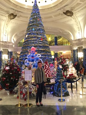 Monaco Reporter standing by the enchanted forest of Christmas Trees