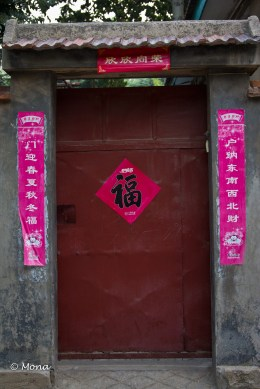 As I understand it, the paper picture and banners call for good fortune, good health, and happiness. They are hung during the Chinese New Year and remain throughout the year as talismans to bring good fortune into the household.