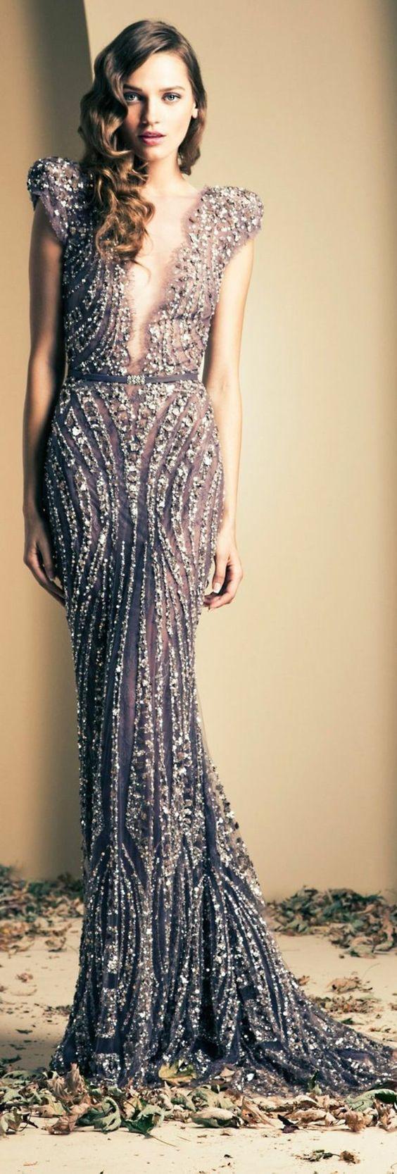 Robe Dubai moderne. Robe Dubai et libanaise grise en dentelle. Robe de soirée Dubai et libanaise à louer, vente sur Paris. Belle robe pour mariage ou soirée.