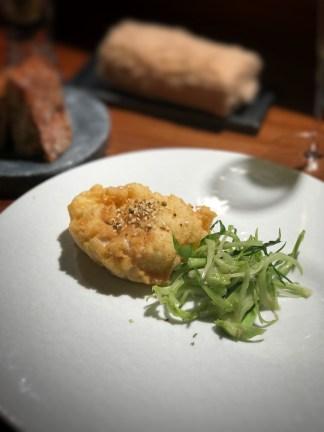 Hokkaido shirako fritter with Yamagata puntarelle (type of chicory), anchovy vinaigrette.