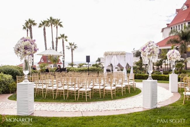 Glamorous-ivory-ceremony-arbor-gold-chiavari-chairs-vista-walk-hotel-del-coronado-wedding