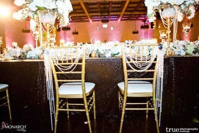 Prado-at-Balboa-Park-wedding-gold-chiavari-with-pearl-decor