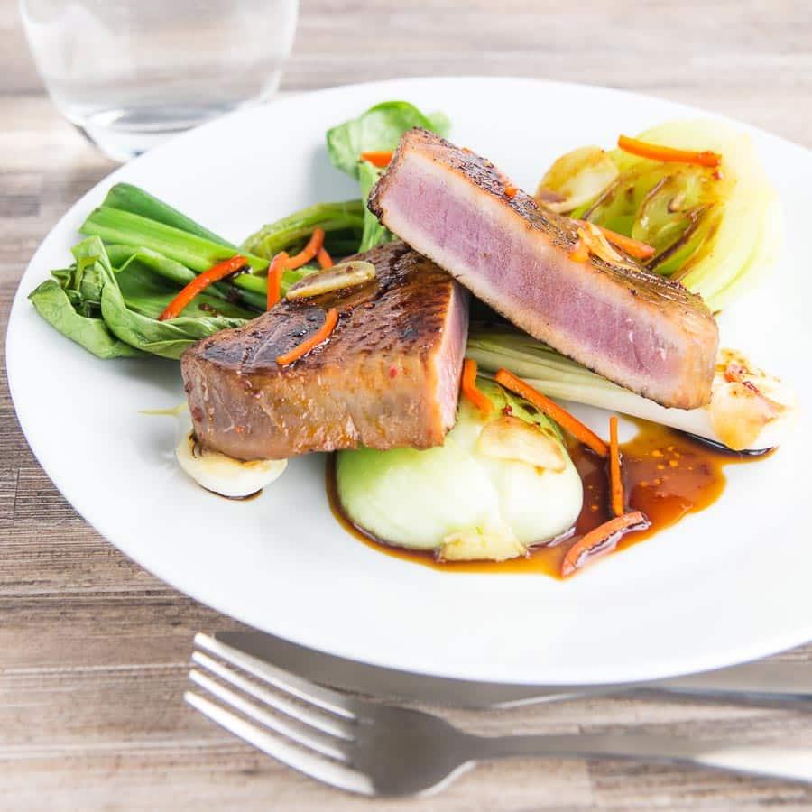 honey and soy glazed seared tuna steak with pak choi