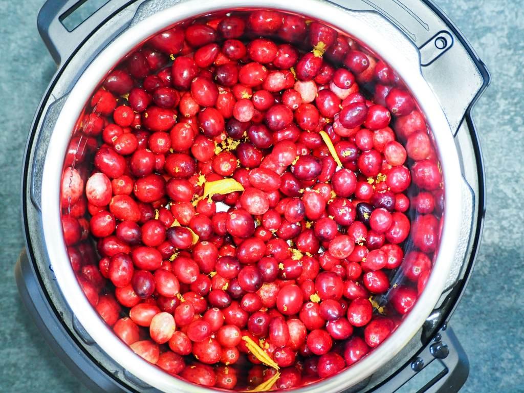 overhead shot of cranberries with orange peels in the intstant pot