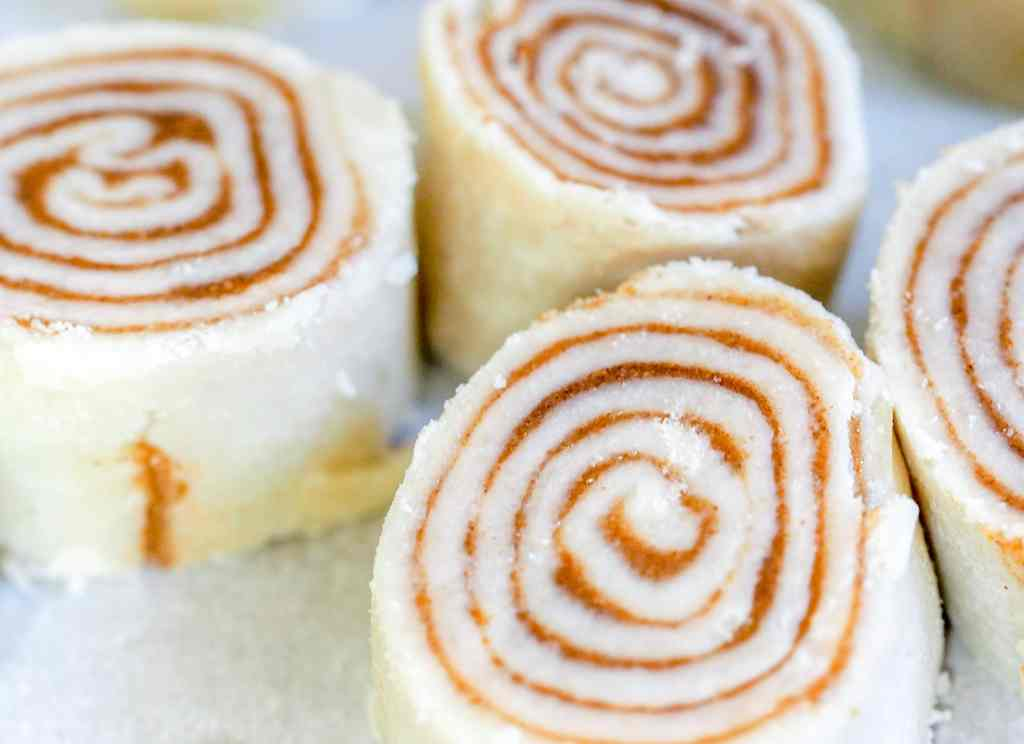 cinnamon roll pinwheel pie pastry sitting on a counter in a group of three