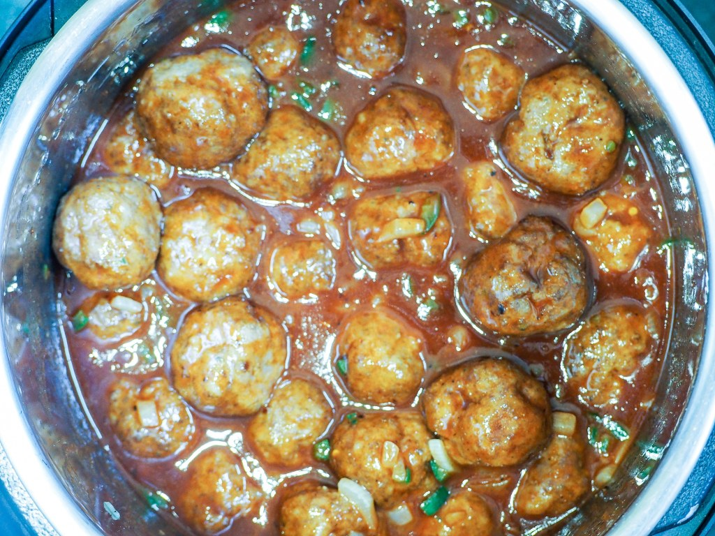 overhead shot of meatballs with bbq sauce in instant pot