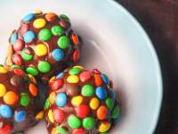 overhead shot of cosmic brownie bites on white plate with blue edge