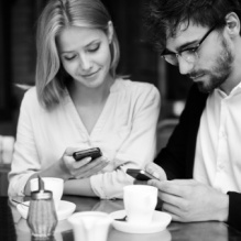 restful-couple-connected-with-smartphone-in-coffee-shop_1098-420